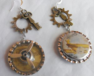 Propeller Earrings with a biplane decoupaged on the back.