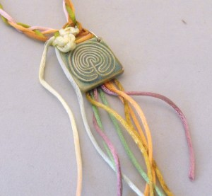 "labyrinth pendant with knots and ""ribbon"""